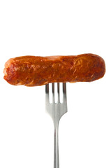 Grilled sausage on a fork