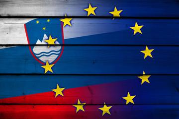 Slovenia and European Union Flag on wood background