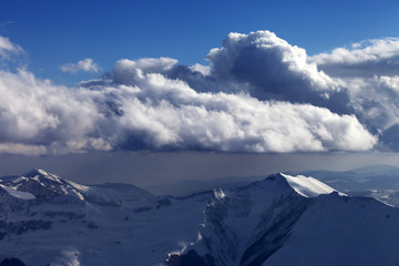 Winter mountains in nice evening and sunlight clouds