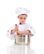 Little boy chef with ladle stirring in the pot