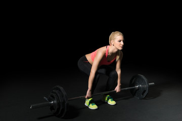 Crossfit woman athlete performs  weight lift