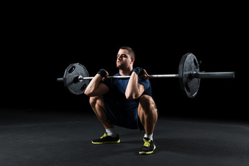 Crossfit athlete performs  weight lift © serbbgd