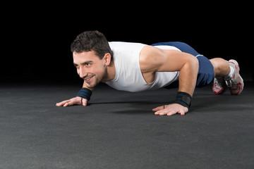Muscular Men Doing Push-ups as part of Crossfit Training