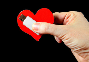 Heart Shape and USB Drive in the Hand