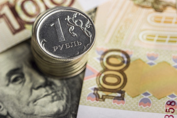 Russian ruble against the background of banknotes