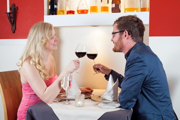 Young couple enjoying a romantic dinner.