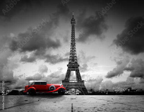 Effel Tower, Paris, France and retro red car. Black and white - 76327230