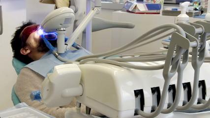 Man during whitening teeth operation