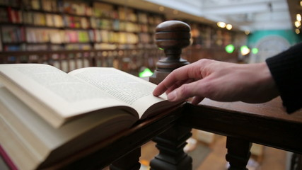 man reading in book inside old library