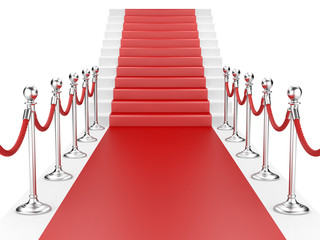 Staircase and red carpet between two metallic stanchions with ro