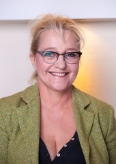 Smiling attractive middle-aged woman with glasses.
