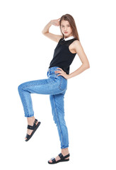 Young fashion girl in jeans posing isolated