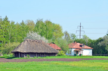 Ancient traditional ukrainian rural wooden barn and hut