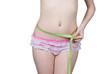 The girl measures the waist