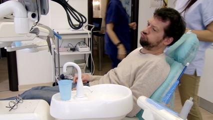 Man sitting in dental office feeling scared
