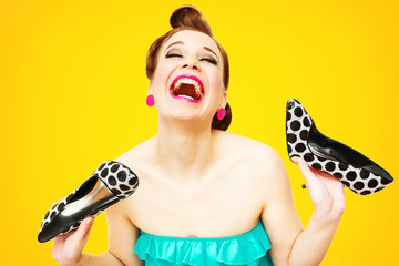 Beautiful pin-up girl gone crazy about new shoes