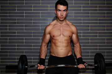 Weightlifter lifting barbell exercising chest and biceps muscle