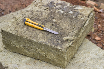 Mineral rockwool panel with a craft knive