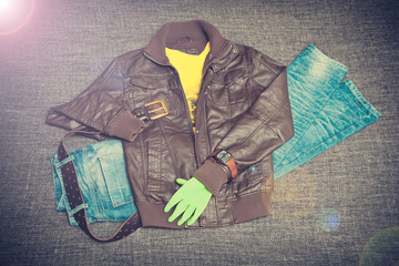 urban fashion: leather jacket, jeans, T-shirt, belt, watch