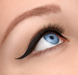 Glamour eye make up close  with black arrow