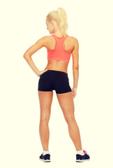 athletic woman in sportswear from the back