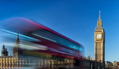 Big Ben and passing red bus in London, United Kingdom