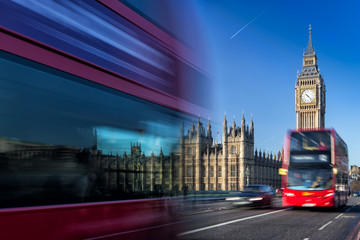 Big Ben and passing red buses, London< United Kingdom