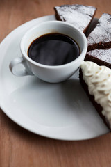 Cup of black coffee and chocolate cake