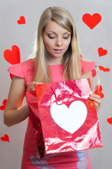 Surprized girl with gift bag