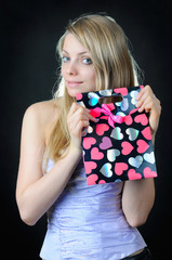 Girl with gift bag with hearts