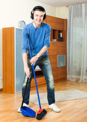 Happy guy with dustpan and brush
