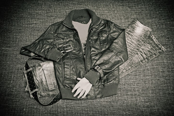 fashion concept - leather jacket, jeans, belt and watch
