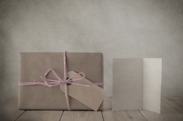 Brown Paper Gift Box with Pink Raffia and Greeting Card
