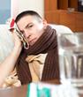 sick  man uses handkerchief on head
