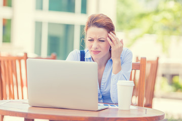 stressed worried business woman sitting in front of computer