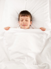 child in white bed