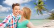 happy couple taking selfie on tropical beach