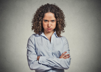 angry young woman puffing cheeks isolated on grey background