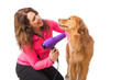 Woman grooming dog with a blowdryer