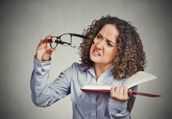 woman can't see read book has vision problems wrong glasses