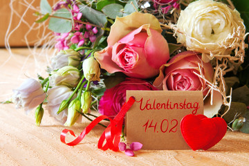 Roses bouquet and Valentine's Day card.