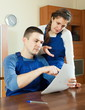 Serious workers with financial documents
