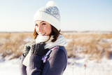 Fototapety Portrait of happy young woman have fun at beautiful sunny winter