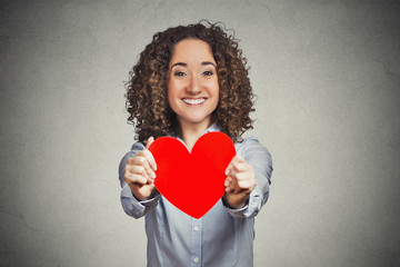 Love valentines day woman holding giving you red heart