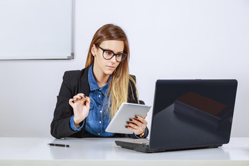 Businesswoman working with digital tablet and laptop