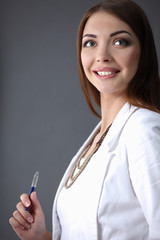Portrait of a business woman holding  folder ,  on grey
