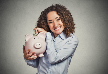 smiling business woman employee student holding piggy bank