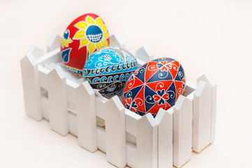 Easter eggs by hand on a white background