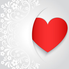 White Valentines Day card with red heart shape