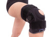 Orthopedic bandage on his knee. Sprain the leg muscles.